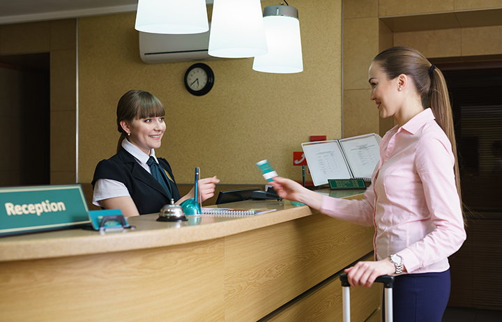 Hostess and guest communicate with each other - Extended Stay Jobs